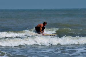 Surfer op de golven | © VLIZ, Leontien De Wulf
